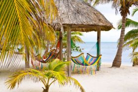 Beach in Placencia, Belize, with two hammocks – Best Places In The World To Retire – International Living
