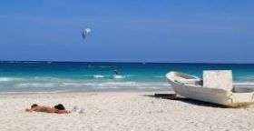 Beach with boat in Yucatan – Best Places In The World To Retire – International Living