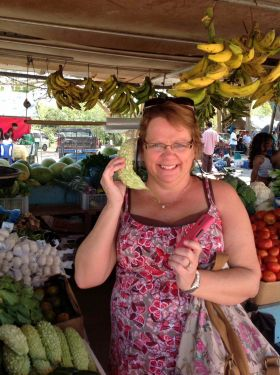 Belize market with woman on banana phone – Best Places In The World To Retire – International Living