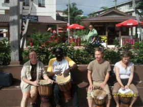 Expats and locals playing the drums in Belize – Best Places In The World To Retire – International Living