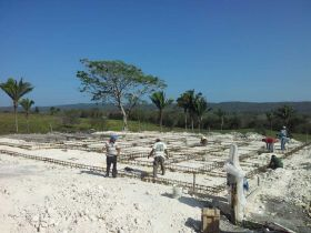 Belizeans working on foundation of villa in Cayo – Best Places In The World To Retire – International Living