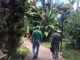 Ben White and Chuck Bolotin walk the grounds of Lake Chapala Society LCS