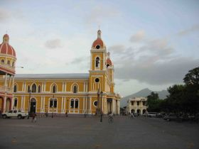 Cathedral of Granada, Nicaragua, with mountains in the background – Best Places In The World To Retire – International Living