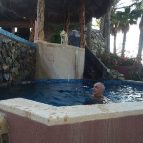 Chuck Bolotin with a dog at Baja de Sueno in Baja California Sur in pool