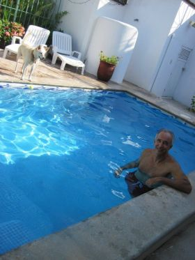 Chuck Bolotin and his dog relaxing at home rental at Lo de Marcos, Mexico