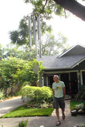 Chuck Bolotin getting close to giant wind chime