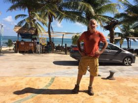 Chuck Bolotin standing in front of the beach at Mahahual, Mexico