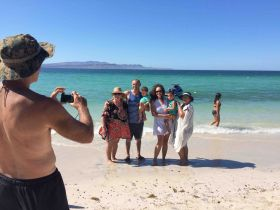 Chuck Bolotin taking a picture at Tecolote, Baja California Sur