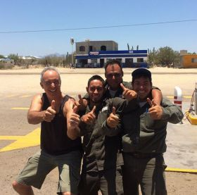 Chuck Bolotin with Pemex attendants in Baja California – Best Places In The World To Retire – International Living