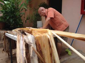 Denis Larsen separating banana fiber at Casa Hamaca, Valladolid, Mexico – Best Places In The World To Retire – International Living