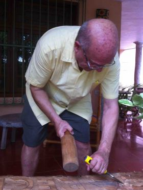 Denis Larsen carving a sign at Casa Hamaca, Valladolid, Mexico – Best Places In The World To Retire – International Living