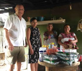 Denis Larsen delivering a dispensa to a family in Yucatan – Best Places In The World To Retire – International Living