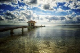 Dock going into the ocean at sunset in Belize – Best Places In The World To Retire – International Living