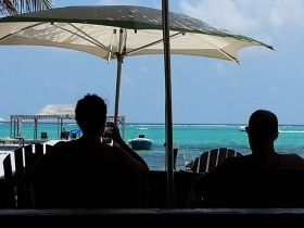 Enjoying the Caribbean during lunch, Ambergris Caye, Belize – Best Places In The World To Retire – International Living