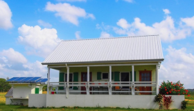 House with solar collector in Carmelita Gardens, Belize – Best Places In The World To Retire – International Living