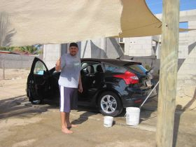 Iran giving thumbs up at carwash in La Ventana Bay, Baja Sur, Mexico