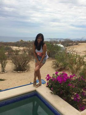 Jet Metier posing on a pool with view of Sea of Cortez in Baja California Sur