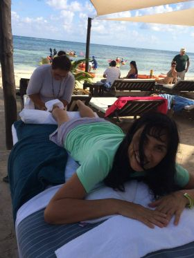 Jet Metier getting a massage on the beach at Mahahual, Mexico