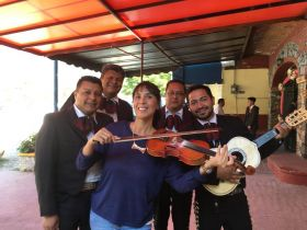 Jet Metier plays the violin at the quinceanera in Ajijic, Mexico
