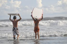 Young men boogie boarding near Coronado, Panama – Best Places In The World To Retire – International Living