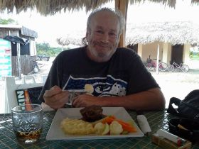 Man eating food in Belize – Best Places In The World To Retire – International Living