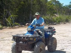 Man riding an ATV in Belize – Best Places In The World To Retire – International Living
