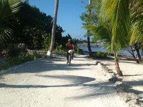 Man riding his bike near the beach in San Pedro, Ambergris Caye, Belize – Best Places In The World To Retire – International Living
