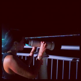 Mary looking through telescope at Coastal Strip in Panama at night – Best Places In The World To Retire – International Living