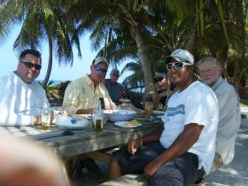 Men eating at a table outside in Corozol, Belize – Best Places In The World To Retire – International Living