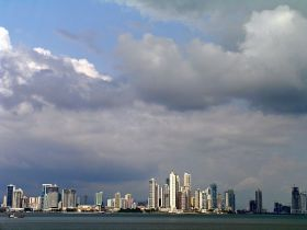 Panama City, Panama, skyline with clouds as viewed from the ocean – Best Places In The World To Retire – International Living