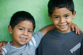 Panamanian elementary school boy with his arm around his slightly older friend – Best Places In The World To Retire – International Living