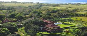 Pedasi arial shot showing hotel, fields nad ocean – Best Places In The World To Retire – International Living