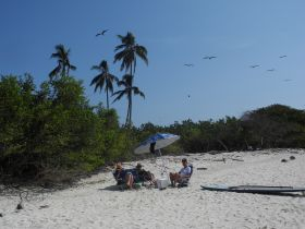 People sitting on the beach in Playa Venao, Pedasi, Azuero Peninsula Panama – Best Places In The World To Retire – International Living