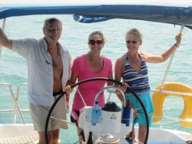 Placencia, Belize expats on a sailboat – Best Places In The World To Retire – International Living
