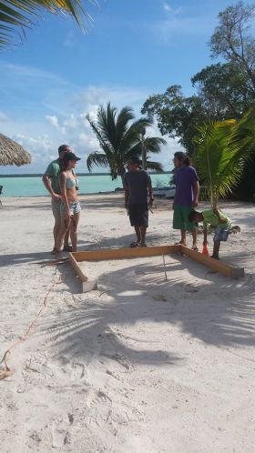Playing horseshoes in front of Blackbeards Bar in Cerros Sands, Corozol, Belize – Best Places In The World To Retire – International Living