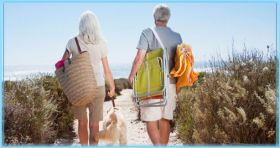 Two retired people walking towards the beach – Best Places In The World To Retire – International Living
