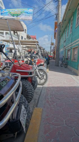 San Pedro Ambergris Caye Golf Carts Parked In Street. – Best Places In The World To Retire – International Living