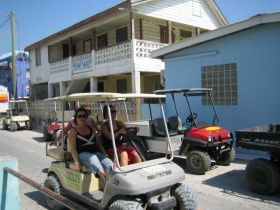 San Pedro Ambergris Caye golf cart in the street – Best Places In The World To Retire – International Living