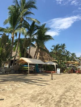 Sayulita Beach with stored surf boards
