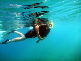 SCUBA diver snorkeling in clear water – Best Places In The World To Retire – International Living