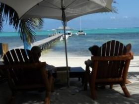 Sitting near a dock in Ambergris Caye, Belize – Best Places In The World To Retire – International Living