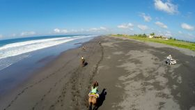 The Gilbert kids caught on an arial photograph horsebacking riding on the beach in Panama – Best Places In The World To Retire – International Living