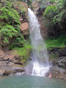 El Valle de Anton, Panama waterfall, with woman near the base – Best Places In The World To Retire – International Living