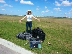 Kristin Wilson with luggage on the ground near the airport – Best Places In The World To Retire – International Living