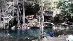 X'Batun cenote in Yucatan, Mexico, with about 10 people in it.