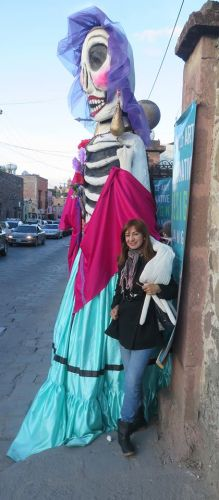 Sonia Diaz next to characteracture at Dia de Muertos in San Miguel de Allende – Best Places In The World To Retire – International Living