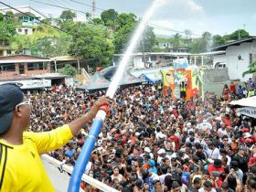 Dousing people with a hose at Panama Carnival – Best Places In The World To Retire – International Living