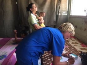 Dr Lori performing a make do examination in a school – Best Places In The World To Retire – International Living