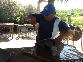 Man carving dinner at Isla Contoy – Best Places In The World To Retire – International Living