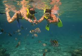 Two snorkelers with fish off Isla Mujeres – Best Places In The World To Retire – International Living